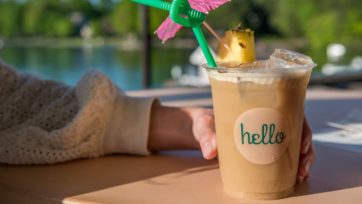 Woman's hand holding fun drink at Hello, Sailor on Lake Norman