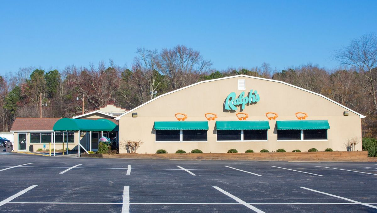 Exterior of Ralph's Barbecue with green awnings during daytime