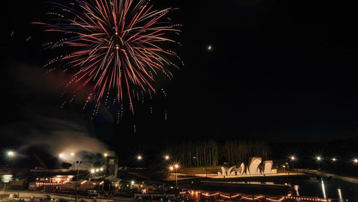 Fireworks bursting over U.S. National Whitewater Center at night