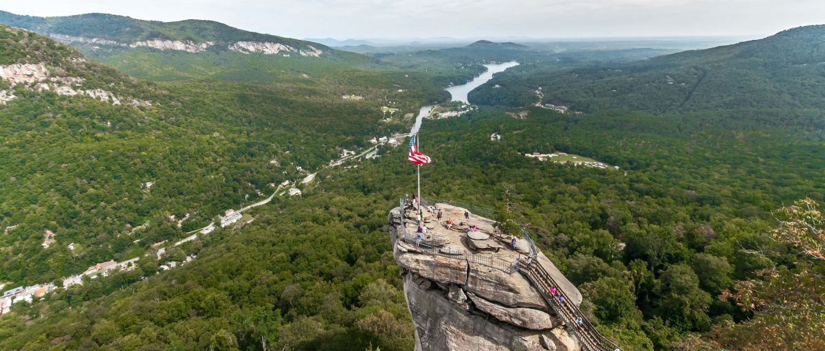 Aerial view of Chimney Rock with river and valley in background on cloudy day