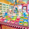 Interior of bright and colorful candy and cotton candy at Belmont Holy Angels Cotton Candy Factory