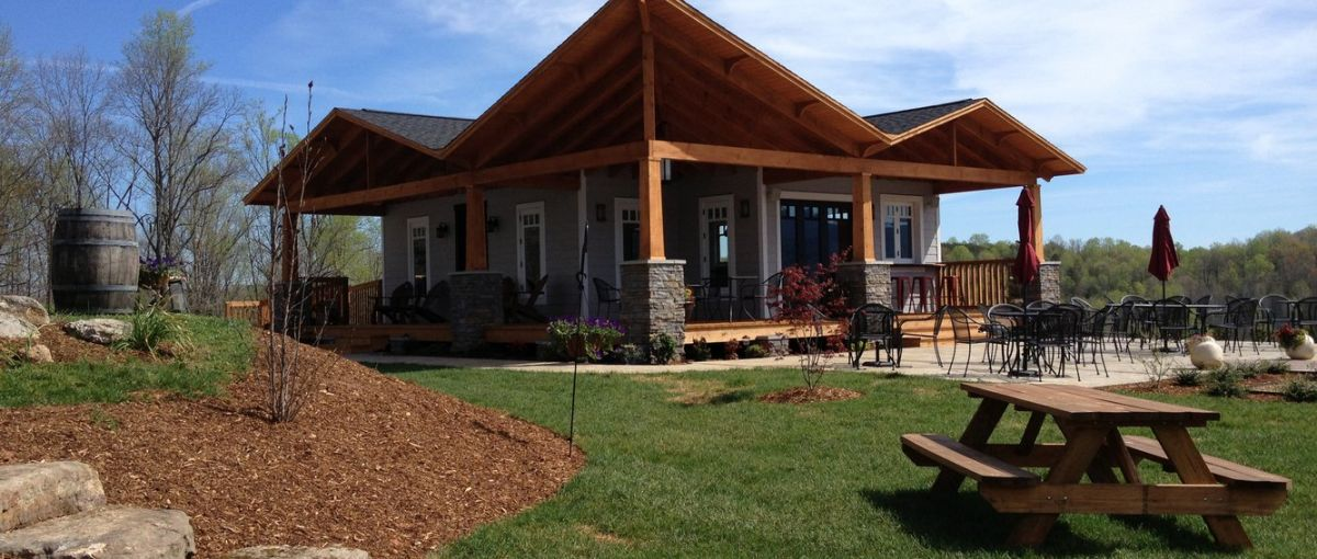 Exterior view of Silver Fork Winery on sunny day with empty patio and lawn in foreground