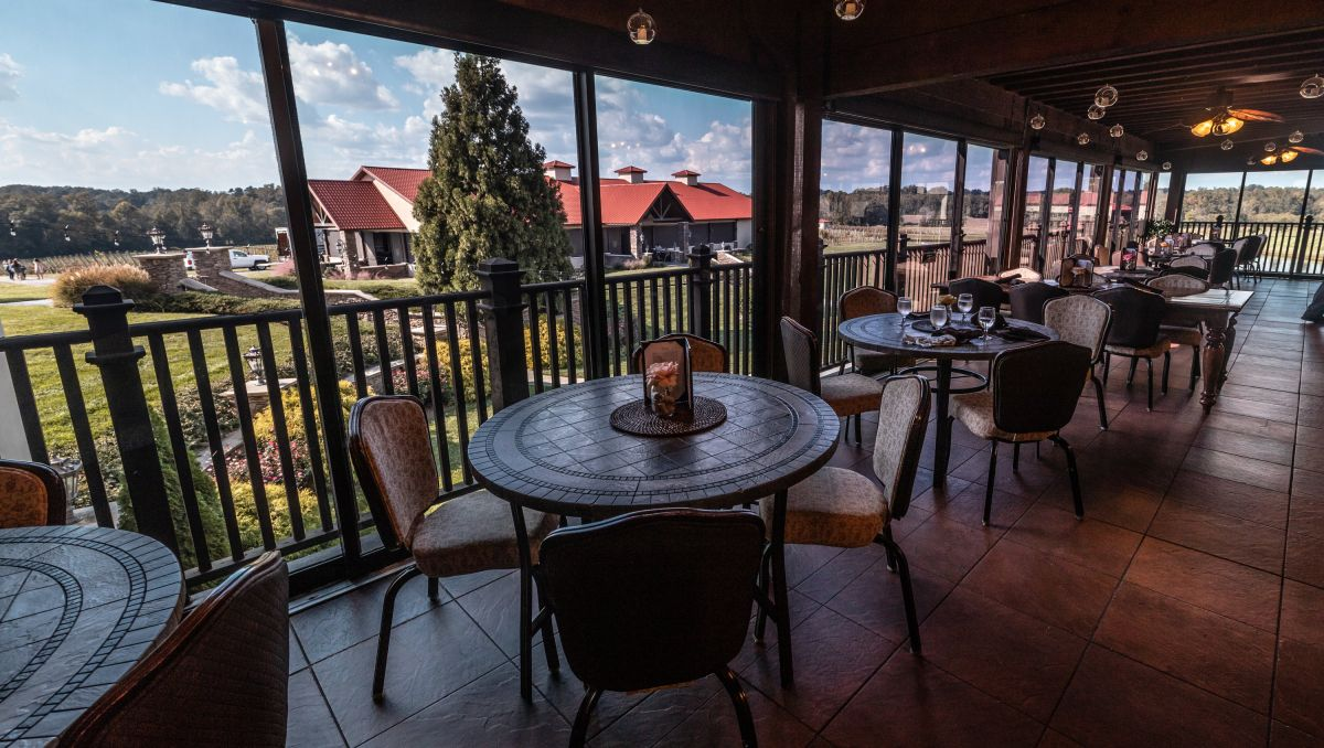 Patio with tables and chairs looking out onto Childress Vineyards