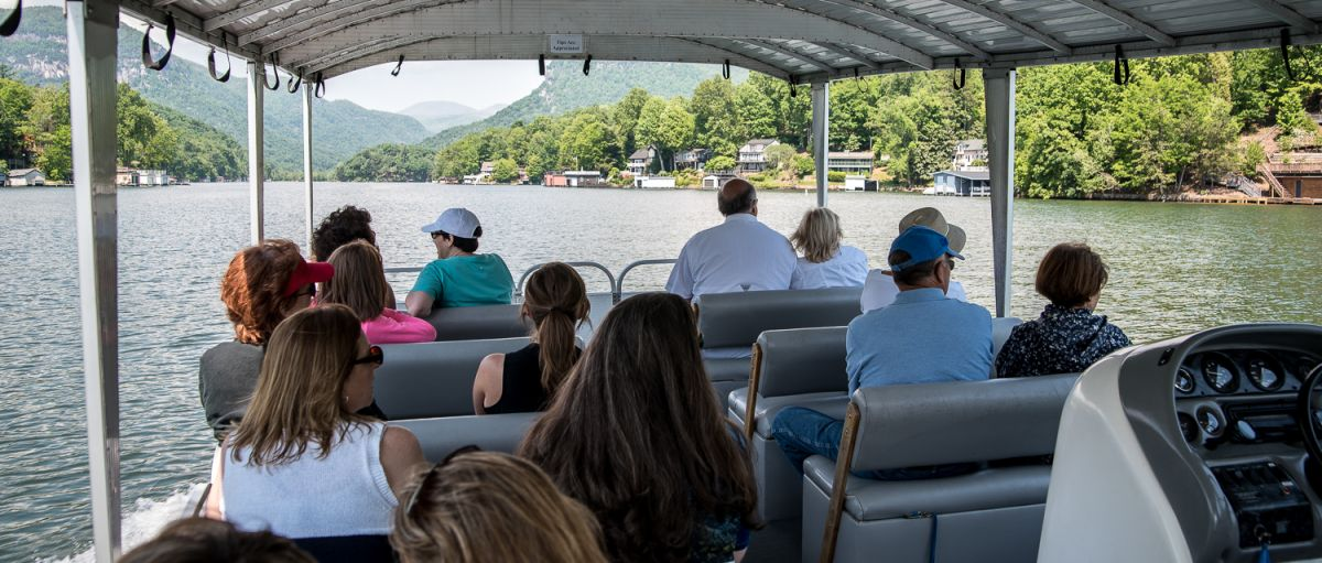 People on boat taking a Lake Lure Boat Tour during daytime