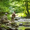 Two men fly fishing at Chetola Resort in Blowing Rock during summer