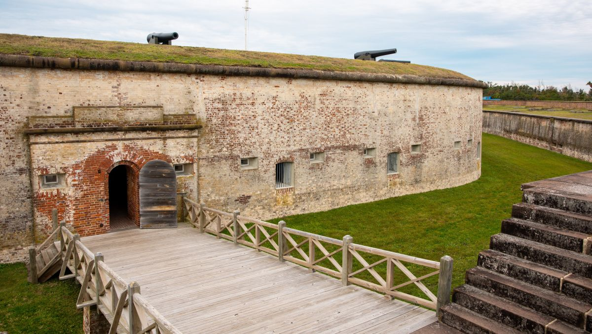 Fort Macon with bridge, moat and cannons on cloudy day