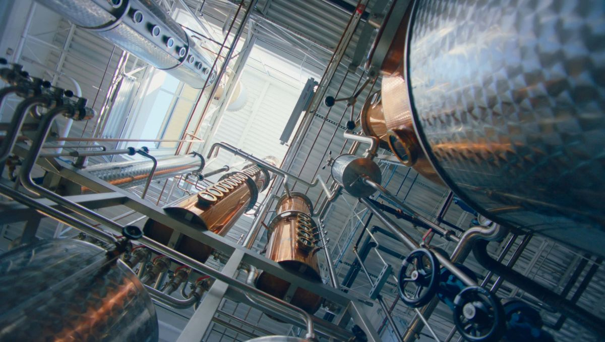Worm's-eye view of distilling tanks at Top of the Hill Distillery