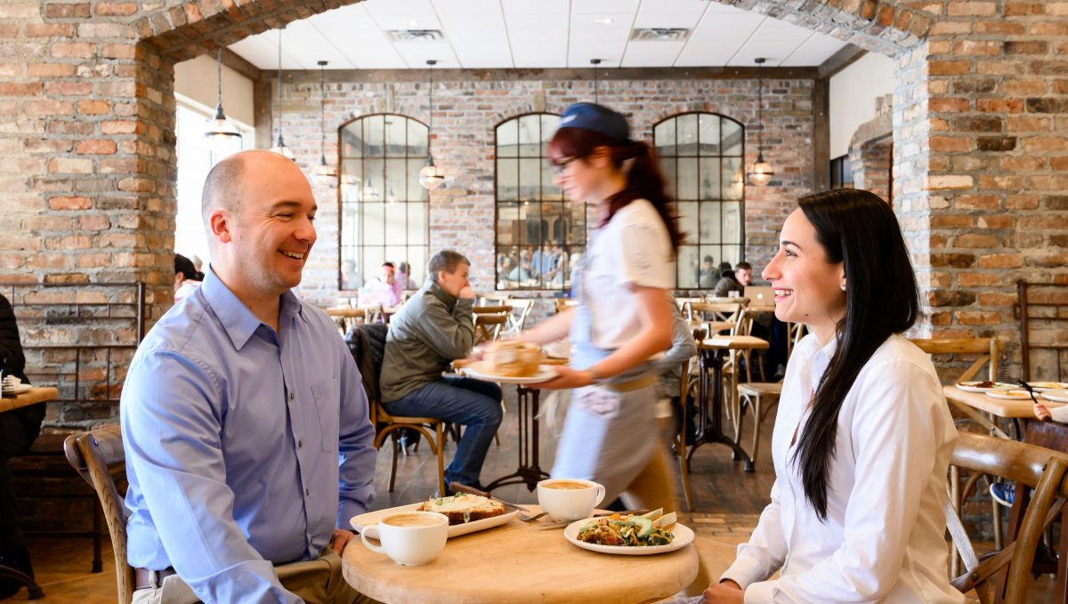 Couple smiling at each other while dining at La Farm Bakery