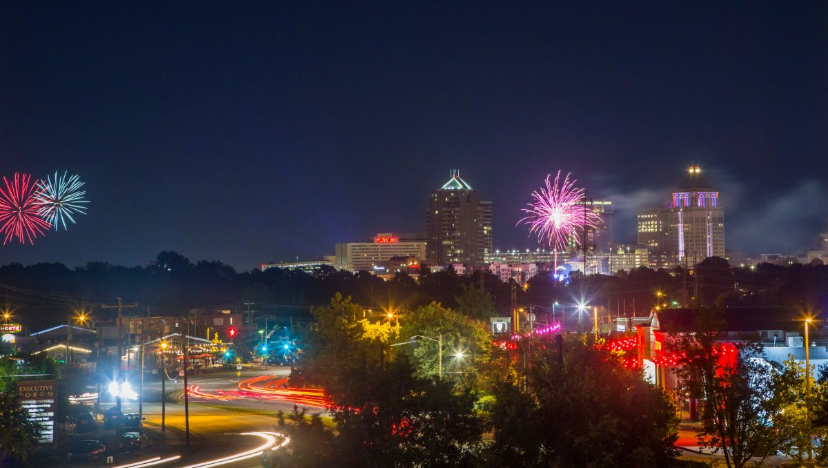 Downtown Greensboro at night with fireworks in the sky