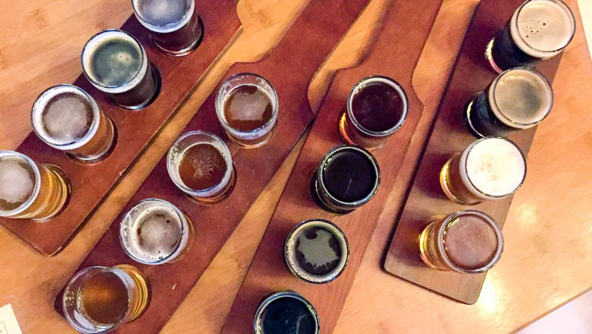 Four flights of beer on a table at Boojum Brewing in Waynesville